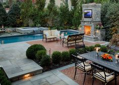 Lovely combination of flagstone and brick for patio