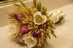 Wheat bouquet with purple and cream tulips.