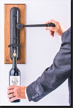 Bon Vivant Wine Opener -  This product is a fully functional, wall mounted antique replica wine opener.
