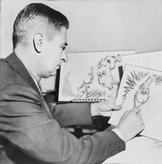 """Ted Geisel, American writer and cartoonist, at work on a drawing of the Grinch for """"How the Grinch Stole Christmas"""", 1957. / Al Ravenna,    Source: Library of Congress. New York World-Telegram & Sun Collection"""