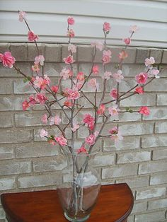 Faux Cherry Blossom ....I did something like this with wrapping/tissue paper and LOTS of modpodge and used in an outdoor pot...it lasted for months!