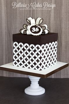 Brown & white gift box cake with geometric pattern