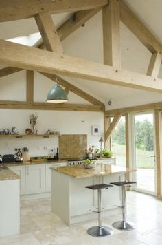 A Facet-Curved Timber Frame House, Featuring a glazed shard cutting through the centre of the building Barn Conversion Interiors, A Frame House, Oak Frame House, Timber Frame Kitchen, Timber Framing, A Frame Cabin, Oak Framed Buildings, Barn Kitchen, Timber House