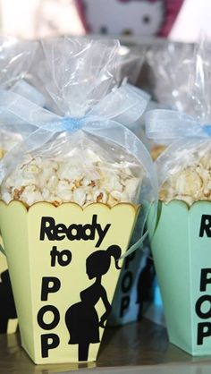 Bucket of popcorn for Alex's party with this sign. Ready to Pop
