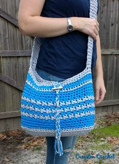 Crochet this fun and easy crochet Boardwalk Crossbody Bag pattern using Lion Brand Fast Track yarn. It is a free pattern on the Croyden Crochet blog.