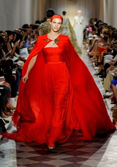 An Italian designer, Giambattista Valli has used red in his shows and has masted the art of draping.