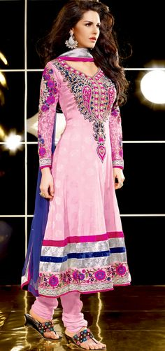 Breathtaking collection of suits with stylish embroidery work and fabulous style.   The dazzling pink crepe jacquard anarkali churidar suit have amazing embroidery patch work is done with resham, zari, stone and lace work.   Beautiful embroidery work on kameez is stunning.   The entire ensemble makes an excellent wear.   Matching santoon churidar and blue chiffon dupatta is available with this suit.   Slight Color variations are possible due to differing screen and photograph resolutions.