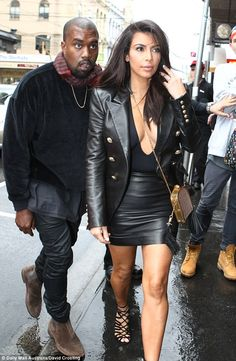Kim #Kardashian rocking leather & high hemlines with  husband #Kanye in Melbourne.   Thx Daily Mail