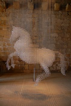 Amazing Stella McCartny horse sculpture using 10,000 swarovski crystals suspended in midair