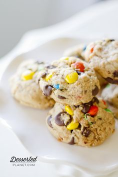 Soft-Baked Monster Cookies LOADED with M's, chocolate chips and Butterfingers.  Perfect for Superbowl! | DessertedPlanet.com