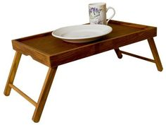 Home Basics Pine Bed Tray by Home Basics. $14.65. Legs fold for easy storage; 12-Inch by 19.5-Inch by 1.5-Inch. Folding bed tray is perfect for breakfast in bed or tv dinners. Pine construction is rustic and sturdy. Bed tray is ideal for breakfast in bed or tv dinners. It folds for easy storage and cleaning. Constructed of fine pine with rustic finish to ensure durability and stability.