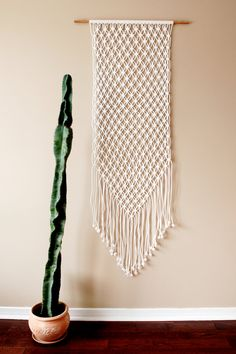 Large White Macrame Wall Hanging. Could be crocheted by doing the love knot stitch.