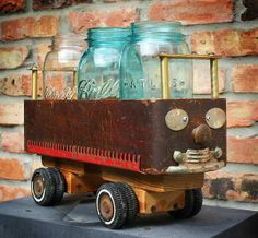 Reserved Upcycled Repurposed Sewing Machine Drawer Wheel Car Centerpiece Basket of Found Recycled Junk Objects Sewing Machine Drawers, Treadle Sewing Machines, Car Centerpieces, Diy Wood Desk, Recycling, Old Drawers, Ways To Recycle, Repurposed Furniture, Repurposed Items