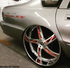 96 impala ss grey red brushed 5 star wheels. badge emblem Rims For Cars, Rims And Tires, Truck Rims, Car Rims, Candy Paint Cars, Old American Cars, Donk Cars, Chevy Impala Ss, Go Car
