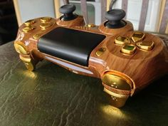 Redditor Electricole's hand crafted PS4 Dualshock 4 wood and gold controller.