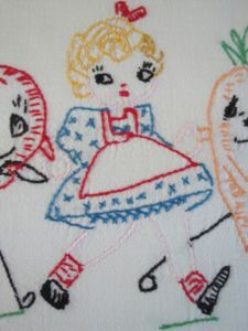 vintage tea towel , my grandmother did these all the time .. I even made a few :)