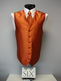 Burnt Orange Vest paired with jeans and cowboy boots for the groom and his men…