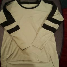 Free People size med long sleeve. Really cool shirt, it's been worn but has no stains or tares. Long, off white with dark brown stripes Free People Tops Tees - Long Sleeve