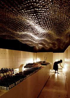 Aesop Adelaide - March Studio - Ceiling made from suspended medicine bottles