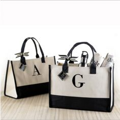 Natural and black canvas tote features black embroidered initial. A classic bag perfectly suited for the mall, office, beach, boating and everyday travel. Makes a great gift for anyone in your life. Fill it with essentials for a friend, sister, daughter, mom and especially a teacher!    19-in. x 17-in.  Canvas