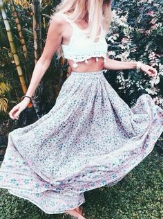 Flawless in a crochet bralet and a floral maxi skirt.