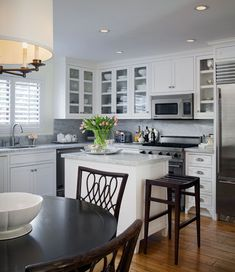 Kitchen - Carrera marble with white cabinets and stainless appliances