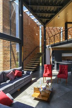 The brick walls act as a sort of fixed shutters, forming a shell around the glass facade on this side of the house