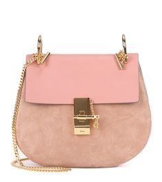 Chloé - Drew leather and suede shoulder bag - We love this pretty pink update to Chloé's 'Drew' bag. The gold-tone hardware accents and super-soft leather and suede promise to add a touch of sophistication to any outfit. Carry yours day and night by the chain over your shoulder. seen @ www.mytheresa.com
