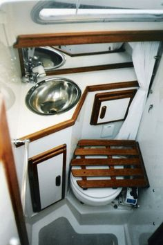 Love the removable seat & extendable sink nozzle for a shower!! Must have!! // 1978 Catalina 27 Sailboat - Cabin Modifications