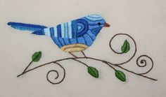 An embroidered bird on a branch....