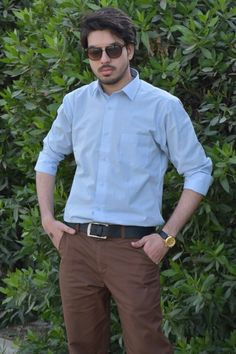 M. Sheheryar Naseer in a light blue shirt along with brown pant #MSheheryarNaseer #Sheheryar #SheheryarNaseer #Sunglasses #Rayban #Watch #Lightblueshirt #Brownpant #photography #man #male #men #menstyle #mensfashion #fashionformen #fashion