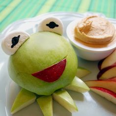 Kermit's Green Apples with Peanut Butter Dip. Good way to get your kids to eat healthy snacks. Cute idea for a Muppet Themed Party. {Muppets} {Fun Food Ideas} {Party Food Ideas} Substitute Sunbutter for the PB