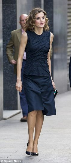 The mother-of-two looked elegant in a ruched navy sleeveless top and a matching skirt