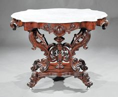 ~ American Rococo Carved Rosewood Center Table ~ liveauctioneers.com