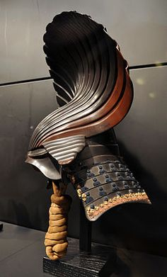 Kabuto are a type of helmet first used by ancient Japanese warriors & later, samuri. Harikake kabuto used papier-mâché mixed with lacquer for the elaborate decoration (the shell) on an iron bowl, beginning of the Edo Period, 17th century. via wiki