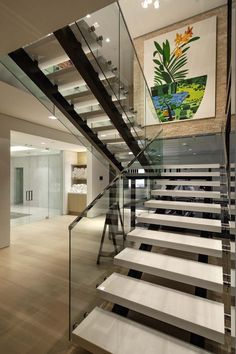 Modern grand staircase with glass railing,u shaped staircase design, comfortable walkway. Modern grand staircase manufacturing company-Demax Staircase&Railing supply all custom staircases. Modern Stair Railing, Modern Stairs, Railing Design, Staircase Design, Glass Stair Railing, Railing Ideas, Staircase Ideas, U Shaped Staircase, Grand Staircase