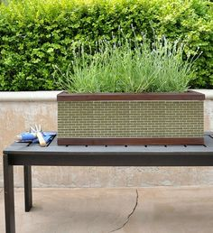 HowTo transform an ordinary redwood planter by applying glass mosaic tile