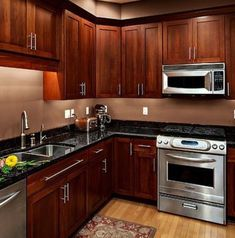 Kitchen of the day a warm tuscan kitchen with rich for Ok furniture kitchen units