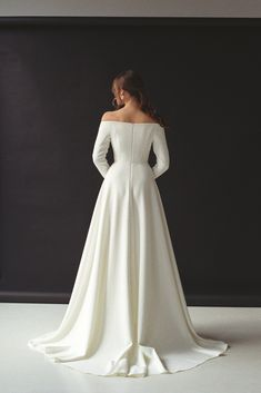 a682f31a40 Modern off-shoulder wedding dress with a split Off-the-shoulder long sleeve  crepe bridal gown Minimalist button front wedding gown SERENA