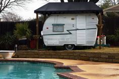 1963 Vintage Shasta Compact Camper. Used as a pool cabana!