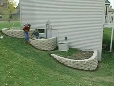 How to build a 3 tier retaining wall on a slope. 0:00the project we've got going here is one of the most typical retaining wall 0:03projects for their help b...