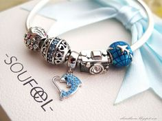 Soufeel Jewelry, Love at Dolphin Bay Dangle Charm 925 Sterling Silver Bracelet. if you like,you can create your own bracelet. Like the  subtle blue.