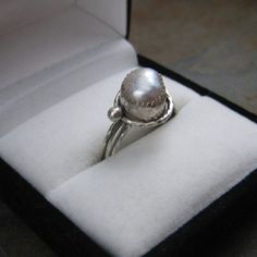 Grey Pearl Ring, put a band of small diamonds beneath, with a woodsy-esque band. Perfection