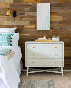 """Room Tour: This Bedroom Gives New Meaning to the Phrase """"Sunny Disposition""""! Explore the space that's making us feel all warm and fuzzy inside. The blogger behind Sugar & Cloth accentuated already-present elements by doing away with dingy window treatments, updating lighting fixtures, and painting the room a light grey, then livened up the space with generous pops of blue, teal, and yellow. Our favourite part? An amazing reclaimed wood wall!"""