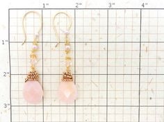 Absolutely gorgeous large faceted Peruvian opal teardrops, complemented with petite rose gold color glass beads, pink Swarovski crystals and pink Swarovski pearls on 14K gold fill earring hooks. The pearls and crystals are loosely wire wrapped for a rustic, yet still romantic effect. These earrings are just stunning and would be perfect for the bride or for an evening dinner out. They measure just 2.75 inches (7cm) long and arrive in a gift box ready for gifting.  You can see more Durango…