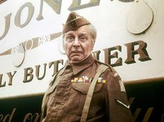Lance Corporal Jack Jones (Clive Dunn) alongside his multi-faceted butcher's van.
