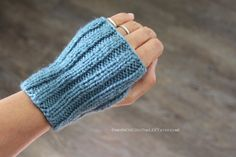 hand knit fingerless gloves  knitted by twoINCHEStoTheLEFT on Etsy