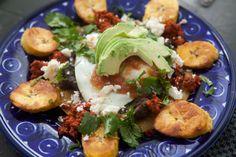 Huevos Motuleños from the Yucatan -- fried eggs, salsa, fried plantains, chorizo, queso fresco, black beans on a tortilla