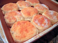 7UP BISCUITS:  2 cups Bisquick; 1/2 cup sour cream; 1/2 cup 7-up;1/4 cup melted butter.   Preheat oven to 450.  Cut sour cream into biscuit mix, add 7-Up. Makes a very soft dough.  Sprinkle additional biscuit mix on board or table and pat dough out. Melt 1/4 cup butter in a 9 inch square pan.  Place cut biscuits in pan and bake for 12-15 minutes or until golden brown.