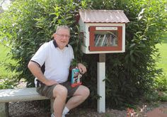 The creator of Little Free Libraries is a Beloiter! Photo shows a happy library-goer